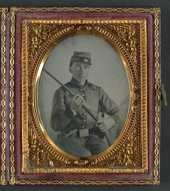 [Unidentified soldier in Confederate uniform with conversion musket and small Bowie knife]