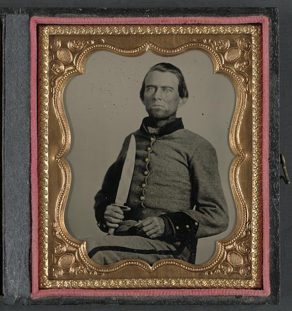 [Unidentified soldier in Confederate uniform with large Bowie knife]
