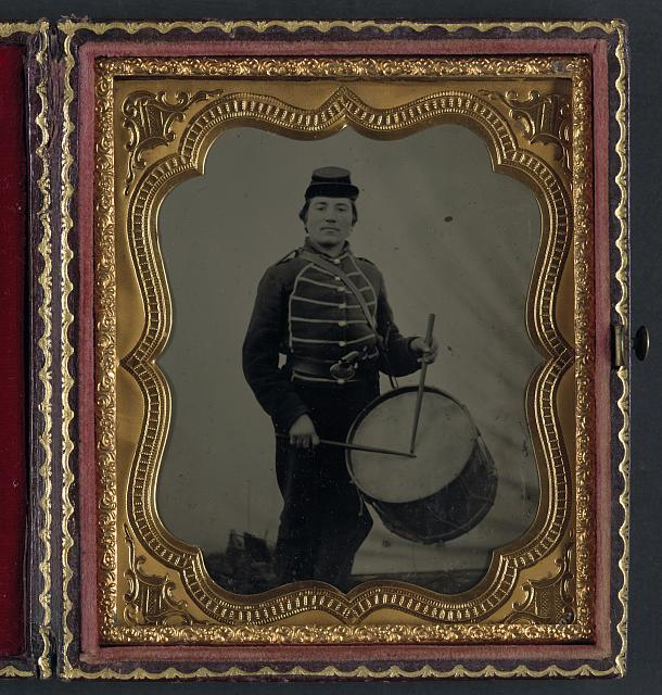 [Private William V. Haines of Company H, 49th Ohio Infantry Regiment, in uniform and Ohio Volunteer Militia belt buckle with drum]