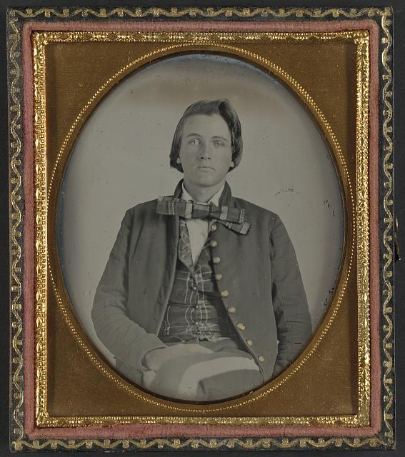 [Unidentified soldier in Confederate nine-button frock coat]