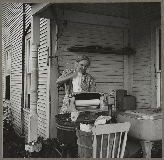 Farm woman washing clothes in her motor-driven washing machine. Near Lincoln, Vermont