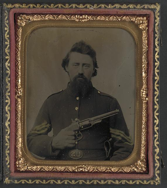 [Unidentified soldier in Union sergeant's uniform and U.S. belt buckle with Savage revolver]