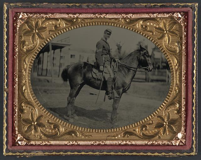 [Unidentified soldier in Union sergeant's uniform with sword seated on a horse]