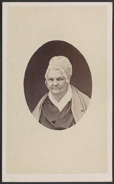 [Unidentified woman, possibly named Lea, in white cap]