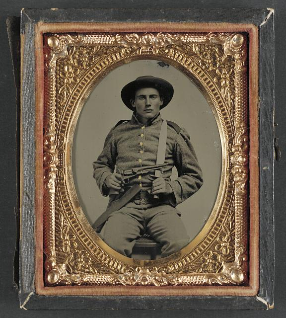 [Private William Anthony Holland of Co. K, 10th Virginia Cavalry Regiment with Bowie knife and Colt Army Model 1860 revolver]