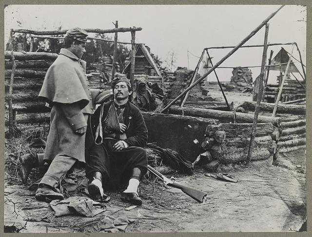 Scene showing deserted camp and wounded soldier (Zouave), 1865(?)