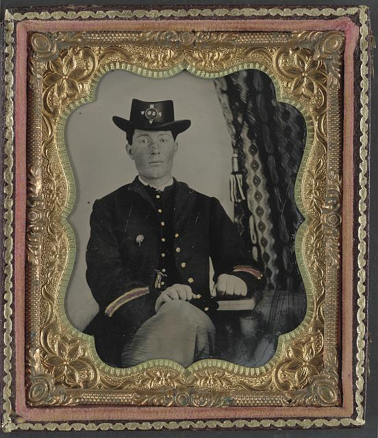 [Corporal John I. Guigher of Co. I, 56th Pennsylvania Infantry Regiment in uniform with book]