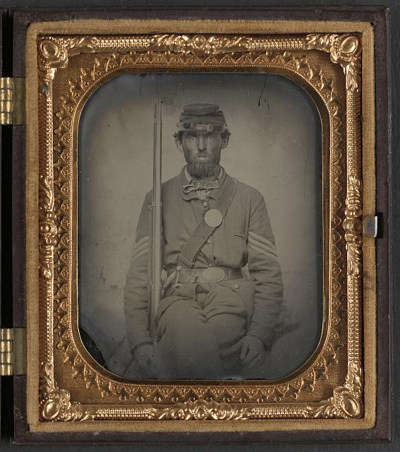 [Unidentified soldier in Union sergeant's uniform with musket and sword]