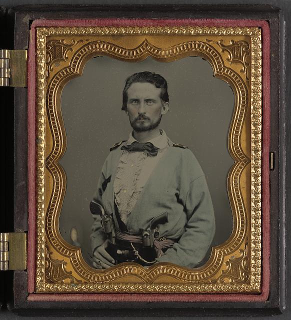 [Unidentified soldier from Kentucky in Confederate uniform with two revolvers]