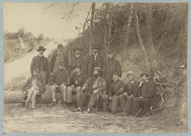 Surgeon John H. Brinton and group of hospital attendants in front of Petersburg, Va., October, 1864
