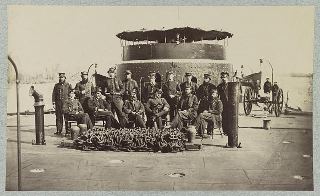 [Fifteen officers on deck of a Union monitor warship]