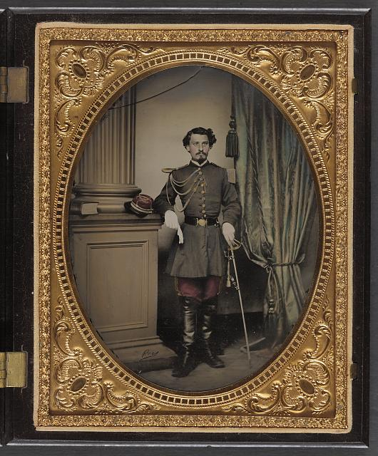 [Unidentified soldier in Confederate officer's uniform with sword]