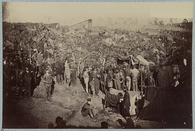 Andersonville Prison, Ga., August 17, 1864. Issuing rations, view from main gate