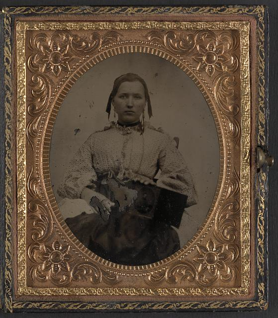 [Sabria Clack with cased photograph of her husband, Private W.R. Clack, of Co. B, 43rd Tennessee Infantry Regiment]