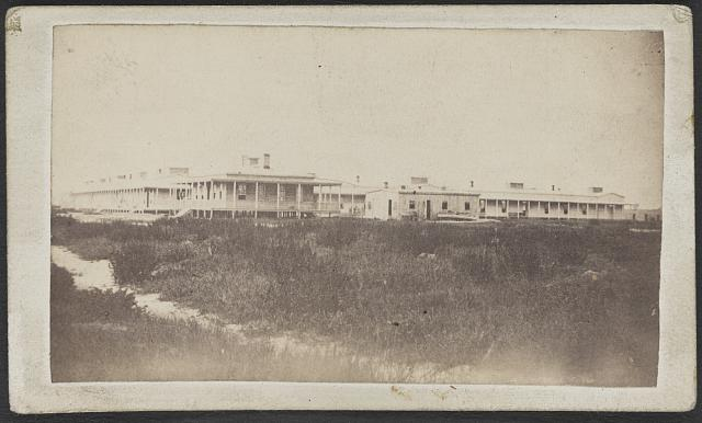U.S. General Hospital, at Hilton Head, S.C. Description: Built facing the ocean on Broad River, (Port Royal Bay.) In form of a square; 200 yards to each face. The residence of the hospital med. director in the left fore ground /