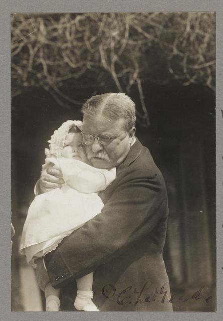 [Theodore Roosevelt holding granddaughter]