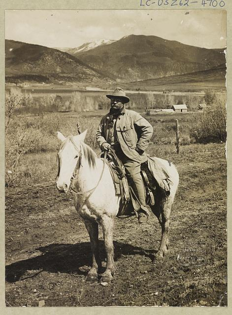 [Happy and hardy after his bear hunt - President Theodore Roosevelt returning to Glenwood Springs, Colorado]