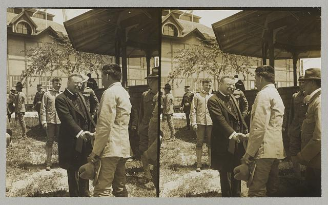 "[Pres. Roosevelt greeting ""the boys"" who fought in Cuba--""Rough Rider"" reunion at San Antonio, Texas]"