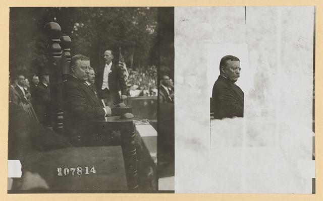 [Theodore Roosevelt seated in large wooden chair watching parade]