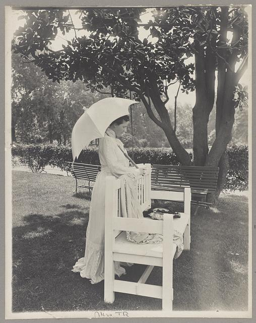 [Mrs. Theodore Roosevelt, full-length portrait, standing by bench, facing right; holding umbrella]