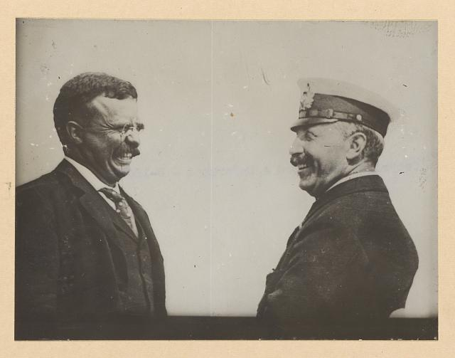 [Theodore Roosevelt and a man in uniform laughing]