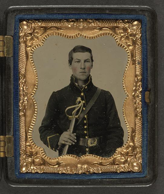 [Unidentified soldier in Union cavalry uniform holding saber]