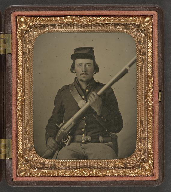 [Unidentified soldier in Union uniform with musket and bayonet in scabbard]