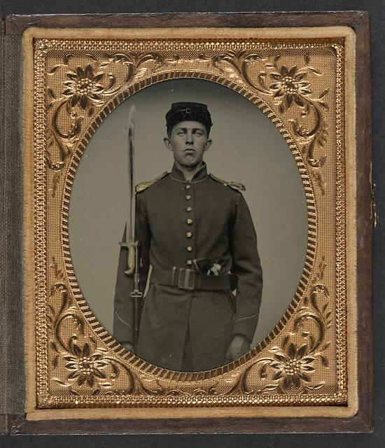 [Unidentified young soldier in Union uniform with revolver, musket, and attached U.S. model 1862 Zouave sword bayonet]