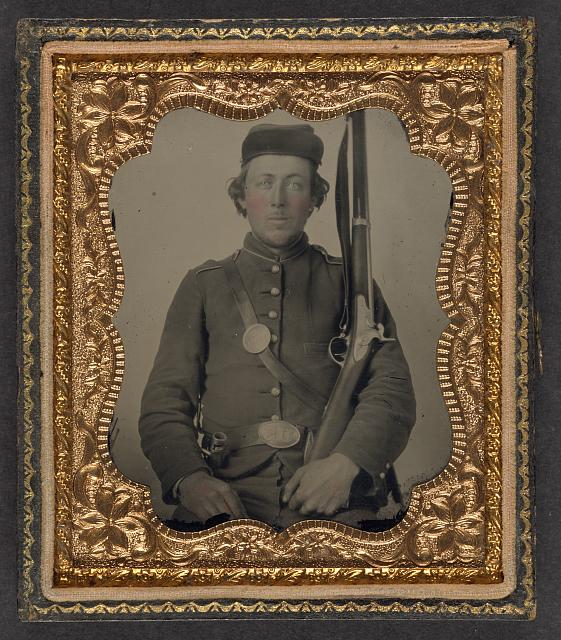 [Unidentified soldier in Union uniform with a musket and bayonet in scabbard]