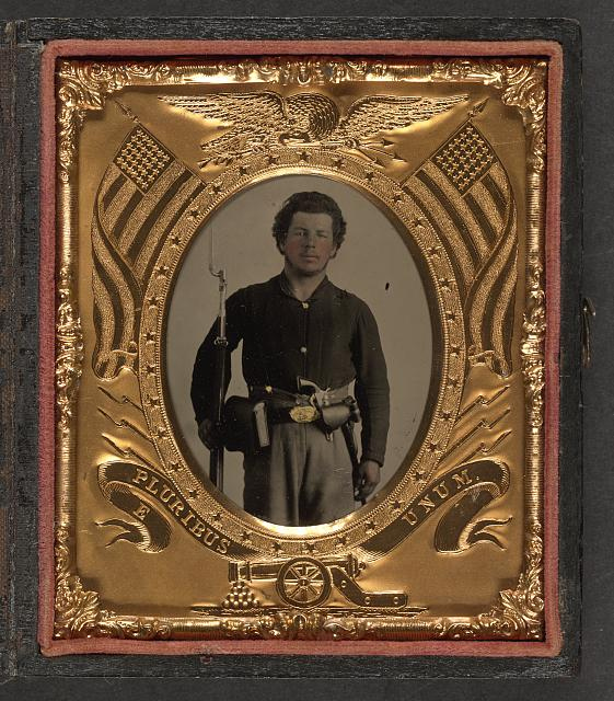 [Unidentified soldier in Union uniform with bayoneted musket, revolver, cap and cartridge boxes, and bayonet in scabbard]