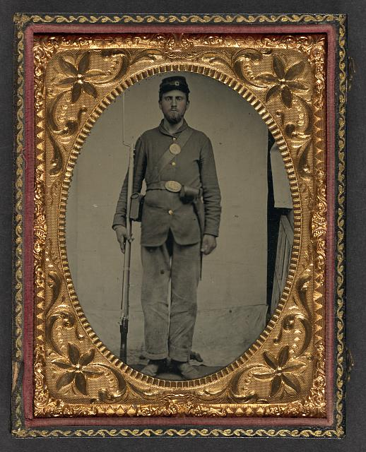 [Unidentified soldier in Union uniform with bayoneted musket, cartridge box, and cap box]