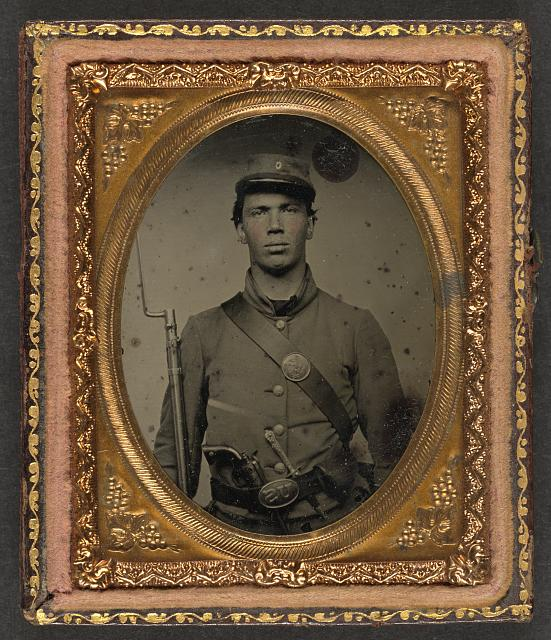 [Unidentified soldier in Union uniform and Company C hat with bayoneted musket, revolver, knife, and cap box]