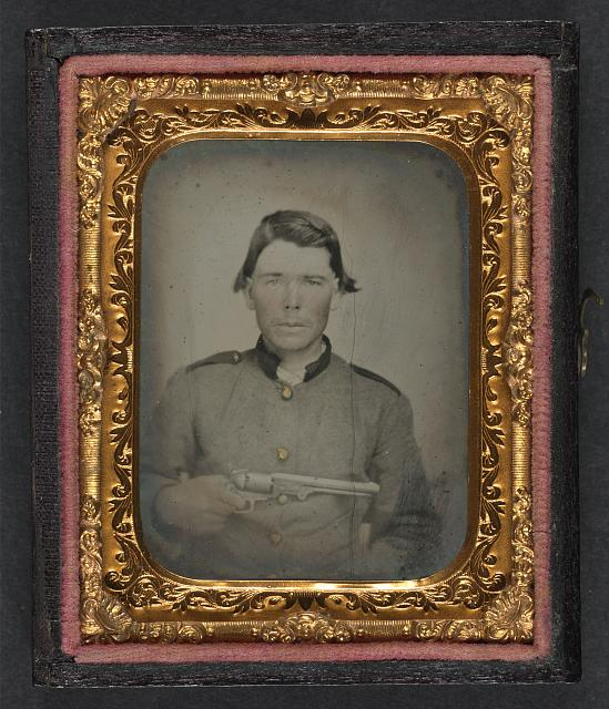 [Unidentified soldier in Confederate uniform with Colt revolver]