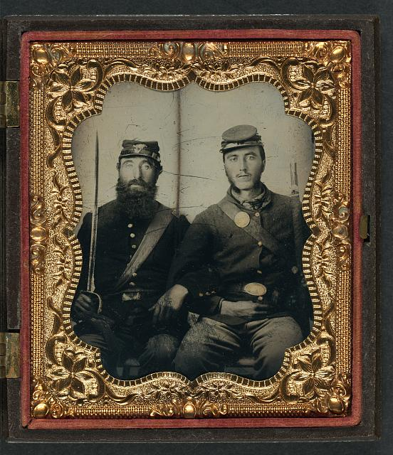[Two unidentified soldiers in Union uniforms and forage caps with saber and musket]