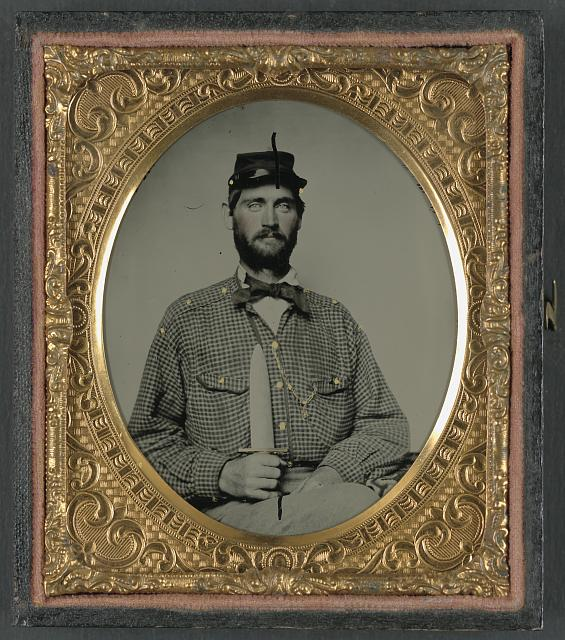 [Captain William H. Powell of Co. A, 33rd Virginia Infantry Regiment in uniform with Bowie knife]