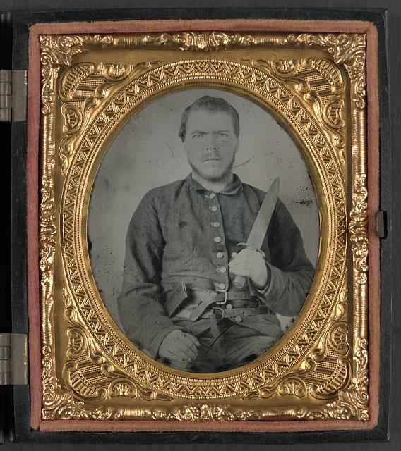 [Unidentified soldier in Georgia Confederate uniform and double roller belt with knife]