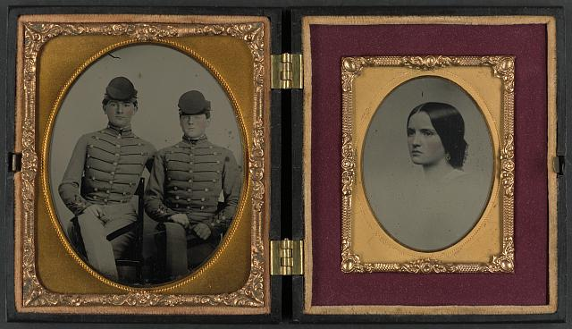 [Privates John James Audubon Powell and Van Franklin Garrett of Co. B, VMI Virginia Infantry Battalion, in uniforms, and unidentified woman]