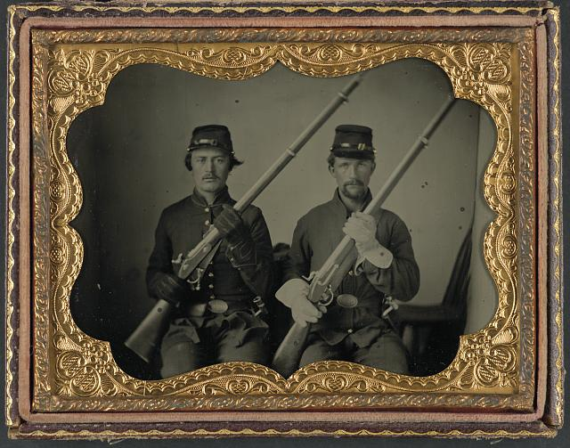 [Two soldiers identified as Wesly Scott and L.P. Nash in Union uniforms and Ohio Volunteer Militia belt buckles with muskets]