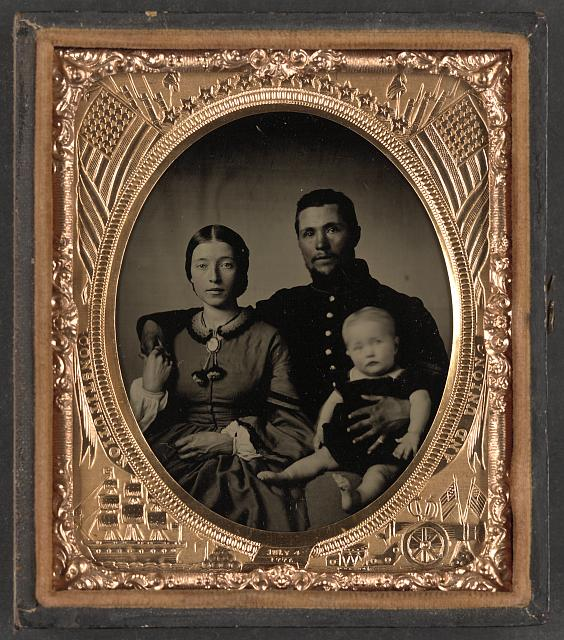 [Unidentified soldier in Union uniform, unidentified woman, and unidentified baby]