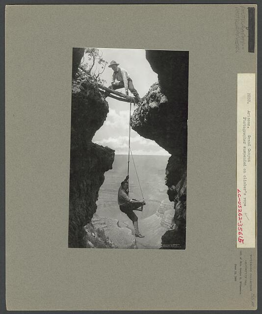 Arizona. Grand Canyon, photographer suspended on climber's rope