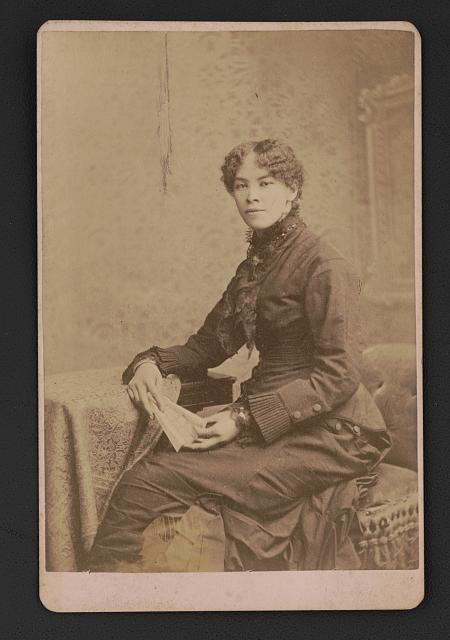 [Josephine A. Silone Yates, educator and activist, seated before studio backdrop]