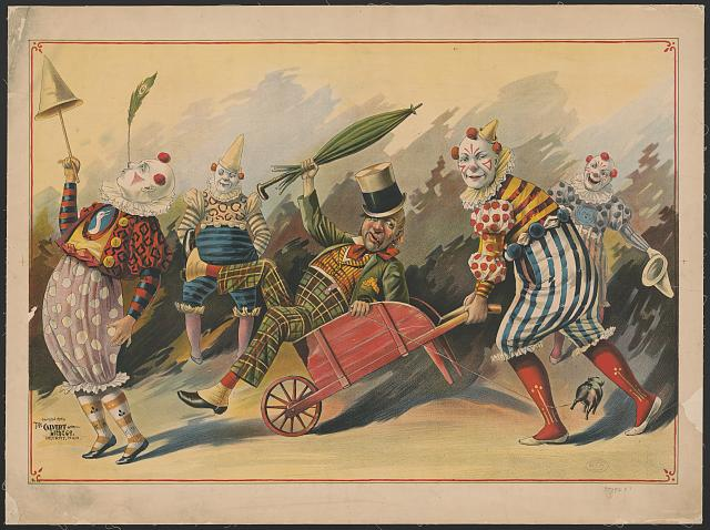 [Five clowns with one in wheelbarrow]