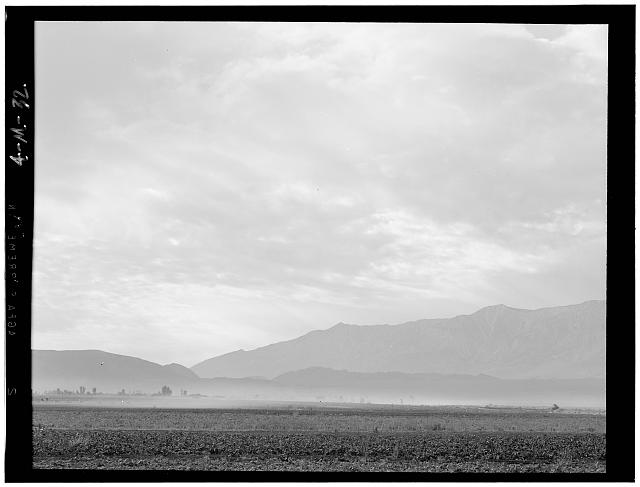 View SW over Manzanar, dust storm, Manzanar Relocation Center