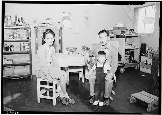 Mr. and Mrs. Henry J. Tsurutani and baby Bruce, Manzanar Relocation Center, California