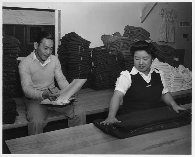 Bert K. Miura and Toshiko Kadonada, bundling and shipping, Manzanar Relocation Center, Cal.