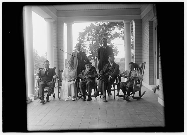 [Group picture of Orville Wright, Bishop Milton Wright, Katharine Wright, Earl N. Findley, nephew Horace Wright, John R. McMahon, and Pliny Williamson, on the porch of Orville's home, Hawthorn Hill; Dayton, Ohio]