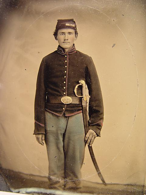 [Unidentified young soldier in Union artilleryman's uniform standing with Eaglehead sword]