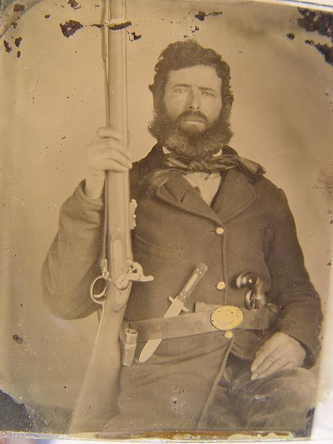 [Unidentified soldier in Union uniform with musket, bayonet and scabbard, Bowie knife, and revolver]