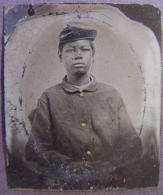 [Unidentified young African American soldier in Union uniform with forage cap]