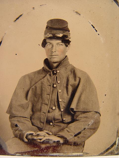 [Unidentified soldier in Union uniform with greatcoat and forage cap]